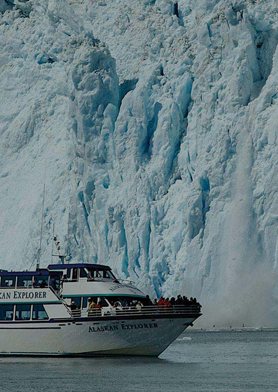 A sightseeing boat next to a glacier calving