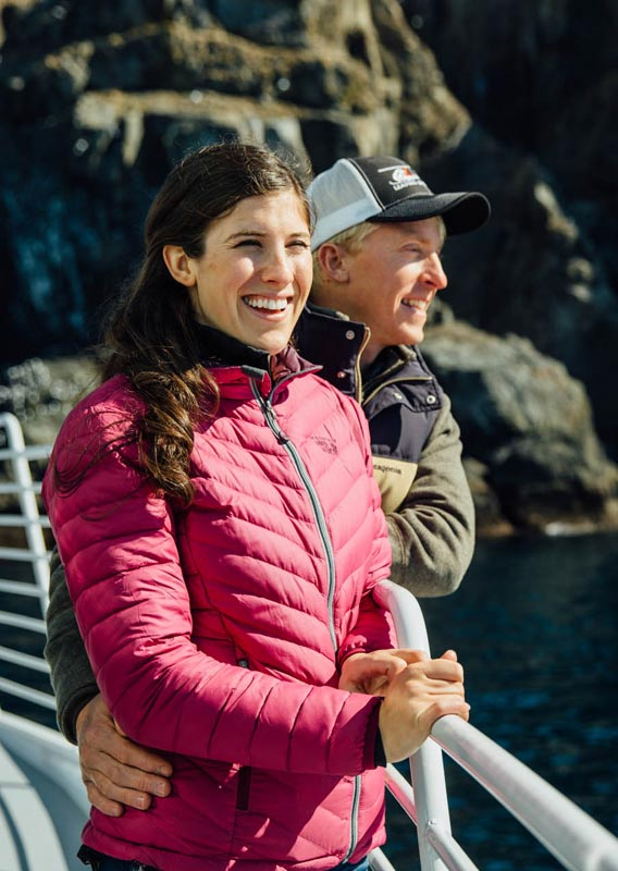 Couple laughing while on Kenai Fjords Tours cruise boat