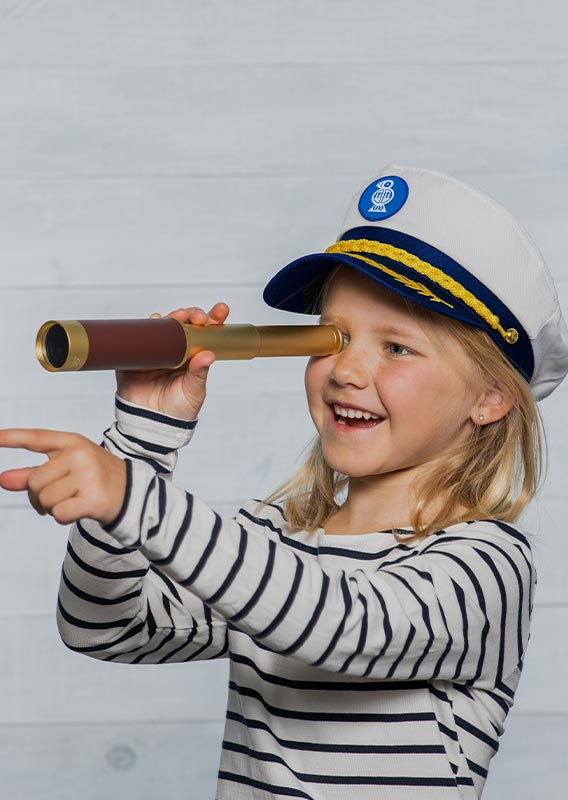 A child holds up a monoscope to look out at something out of view.