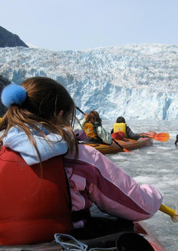Kayakers approach a glacier