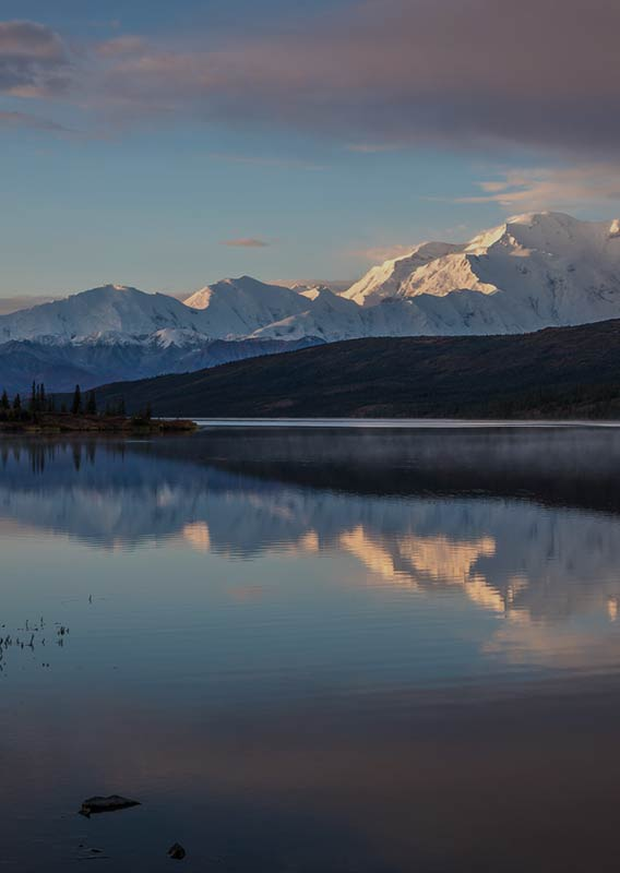 Denali mountains reflecting on Wonder Lake in the heart of Denali National Park