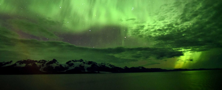 Aurora Borealis over an Alaska mountain range