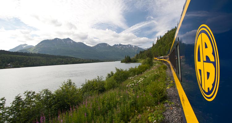 A view from the Alaska Railroad of a river and mountains.