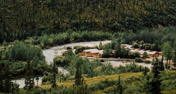 An aerial view of the Denali Backcountry Lodge next to a river.