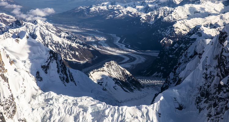 An aerial view towards a glacial flow.