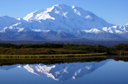 View of Denali mountain reflecting in Wonder Lake